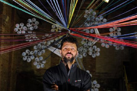 Conrad Shawcross installs his 'Chord' spinning machine into the Jute shed at Dean Clough Mills.
