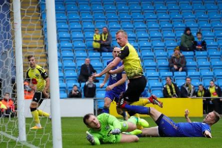 Mark Beck nets his second of the afternoon in Harrogate Town's FA Cup win at FC Halifax Town. Picture: Matt Kirkham