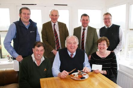 Ian Bell, chief executive of the Addington Fund, prepares to tuck into his charity breakfast, joined by hosts Chris and Christine Ryder. Standing, from left, are Barclays' regional agricultural manager Ian Robson, Craven Cattle Marts' general manager Jeremy Eaton, CCM director Kevin Wilson and Barclays' regional agricultural director John Pinches (s).