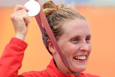 Jess Learmonth with England's first medal of the 2018 Commonwealth Games