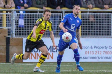 Jack Emmett and Lee Shaw compete for the ball during the 1-1 draw between Harrogate Town and Chesterfield at the CNG Stadium earlier this season. Picture: Matt Kirkham