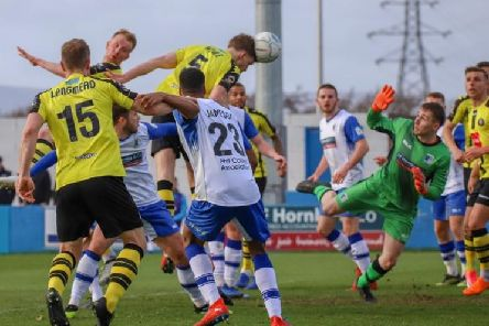 Callum Howe heads home Harrogate Town's equaliser at Barrow. Picture: Matt Kirkham