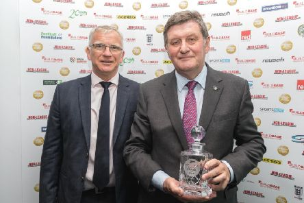 Mike Partridge, associate director of Harrogate Town, with the clubs Best Away Day Award at Chelseas Stamford Bridge.