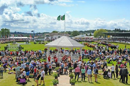 Visitors on the Presidents Lawn, the bandstand and the cattle parade in the main ring at the Great Yorkshire Show. Picture Tony Johnson.