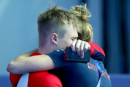 Harrogate diver Jack Laugher is consoled after missing out on a gold medal at the World Championships in South Korea. Picture: Getty Images
