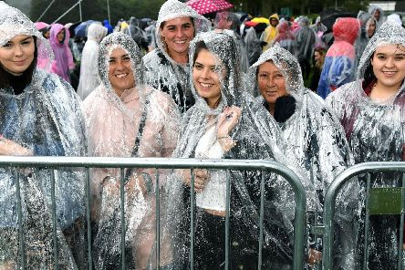 Fans in their ponchos queue to get into Ed Sheeran's gig at Roundhay Park.