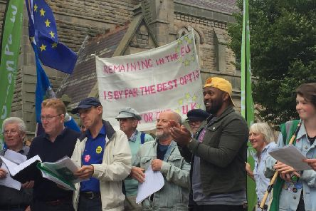 With his customary backwards-cap, MEP Magid Magid joins in a Yorkshire for Europe rally in Harrogate on Wednesday. Picture: Lachlan Leeming