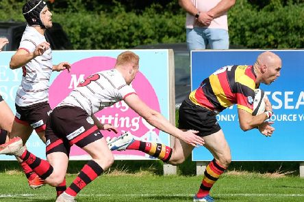 Dave Doherty on his way to the try-line during Harrogate RUFC's derby win at Ilkley. Picture: Richard Bown