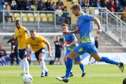 Jon Stead converts from the penalty spot during Harrogate Town's National League defeat to Torquay United. Picture: Matt Kirkham