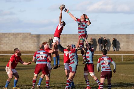 Horden and Peterlee (mauve and blue) v Stockton (red) rugby action. Picture by Tom Banks.