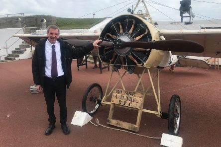 Mike Hill with a First World War bi-plane at the Heugh Battery in Hartlepool.