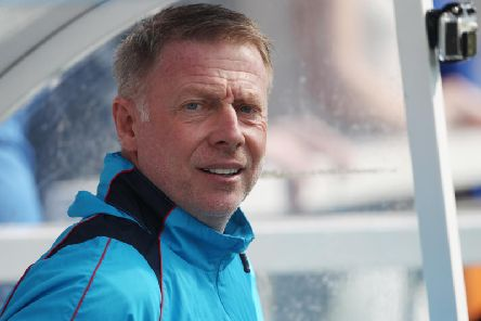 Hartlepool United, managed by Craig Hignett (above) travel to Holker Street to take on AFC Barrow today.