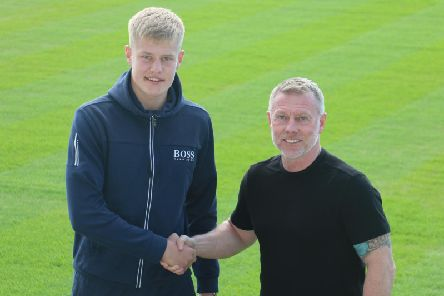 Brad Young with manager Craig Hignett (pic via HUFC).