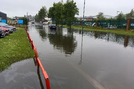 Flooding in Hartlepool, with standing water on the road.