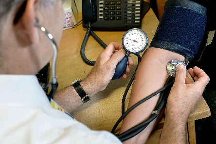 A GP at work. PA Wire/PA Images