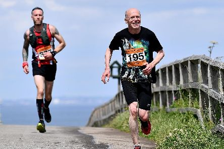 Runners taking part in the Durham Coastal Half Marathon arriving at Crimdon Picture by FRANK REID