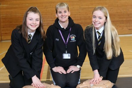 Life-saving skill: Frances Hammond teaches CPR to pupils Katie Brook, right, and Megan Hodson.