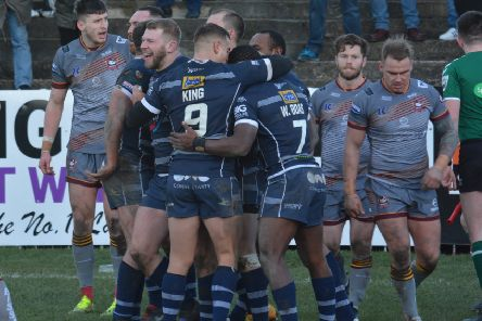 Featherstone Rovers players celebrate a try against Batley Bulldogs. Picture: Rob Hare