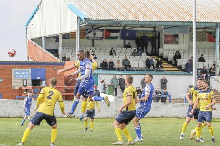 Jameel Ible climbs high to head home Frickley Athletic's goal against Tadcaster Albion. Picture: Onion Bag Photos