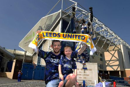 James keenan and his son Freddy, aged four, from Birstall, were among those outside Elland Road yesterday. Picture by Simon Hulme