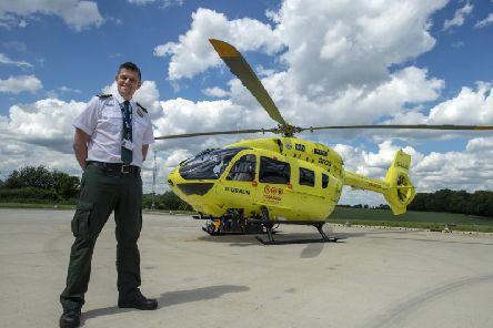 Matthew Syrat, clinical operations manager for the Yorkshire Air Ambulance, in front of the H145 helicopter
