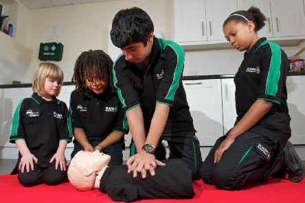 Enthusiastic Badgers practising their first-aid skills at a St John Ambulance unit.