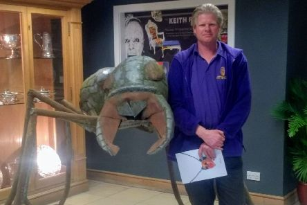 Hucknall artist Gavin Darby with his giant ant creation at the auction.