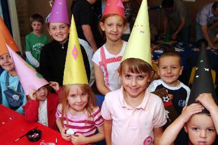 2006: Children from Saplings Stay and Play in Hucknall show off their artistic flair with these hats they made. Are you on this picture?
