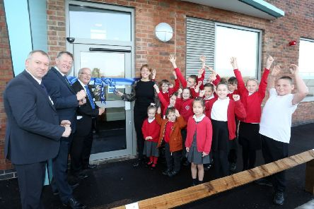 Headteacher Rachel Jarvis (centre) pictured alongside students as she cuts a ribbon to officially open the new Hawthorne Primary and Nursery School in Bestwood Village. Also pictured, from left, is Kevin Taylor of Arc Partnership, cllr Chris Barnfather and cllr Philip Owen.'The official opening of Hawthorne Primary & Nursery School, Keepers Close, Bestwood Village.'A special assembly with performances, poems and readings from pupils across all year groups took place, before a ceremonial ribbon cutting to officially mark the opening of the new Hawthorne Primary School in Bestwood Village, Nottingham. 'Wednesday 20th November 2019. (Photo: Joseph Raynor/Nottingham Post)