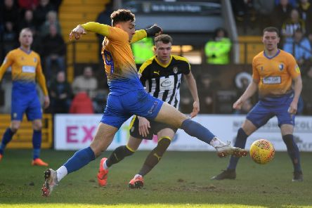 Tyler Walker stretches for the ball at Meadow Lane.