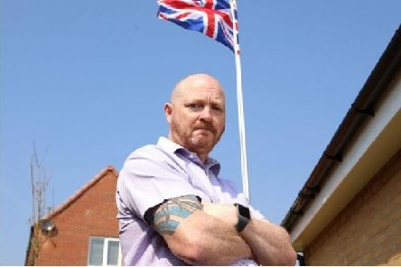 Andrew Smith installed the flag on a pole in tribute to Great Britain after serving six years in the Royal Signals.