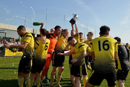 Hucknall Town's players celebrate their title win.