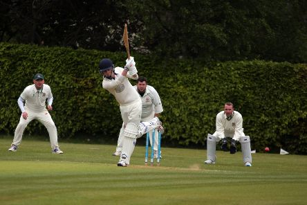Papplewick opening batsman Joe Walker drives Ben Perkins square on the legside.