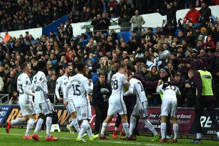 Swansea City celebrate after scoring their second goal against  Manchester City at The Liberty Stadium on 16th March.