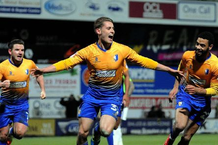 Danny Rose celebrates scoring for Mansfield.