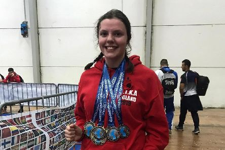 Megan Hately with the medals she won at the Unified World Kickboxing Championships in Italy.