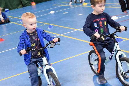 Youngsters get on their bikes.