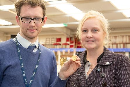 Hansons valuer Edward Rycroft with the coin and its owner Amy Clapp.