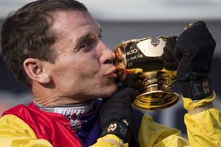 Champion jockey Richard Johnson kisses the Cheltenham Gold Cup after victory on Native River at last year's Festival. (PHOTO BY: Justin Setterfield/Getty Images)