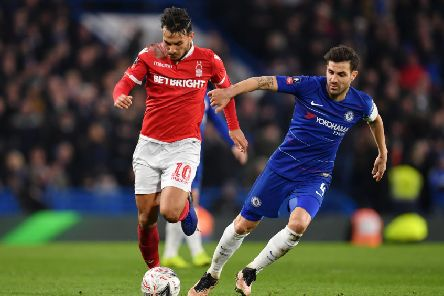 LONDON, ENGLAND - JANUARY 05:  Cesc Fabregas of Chelsea battles for possession with Joao Carvalho of Nottingham Forest during the FA Cup Third Round match between Chelsea and Nottingham Forest at Stamford Bridge on January 5, 2019 in London, United Kingdom.  (Photo by Justin Setterfield/Getty Images)