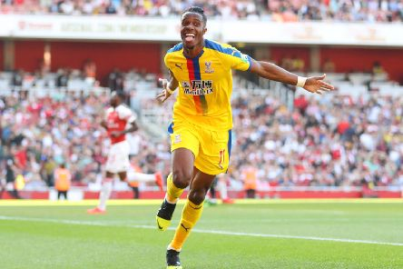 LONDON, ENGLAND - APRIL 21: Wilfried Zaha of Crystal Palace celebrates after scoring his team's second goal during the Premier League match between Arsenal FC and Crystal Palace at Emirates Stadium on April 21, 2019 in London, United Kingdom. (Photo by Warren Little/Getty Images)