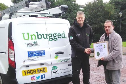 Left Lee Illingworth from Unbugged receives a framed certificate from Ian Hughes of Oakstone Environmental Consulting.