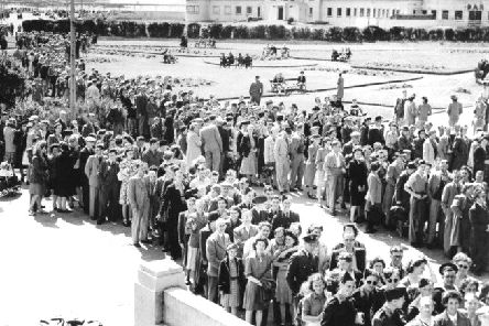 Queues of people waiting outside the super swimming stadium in Morecambe in 1945.