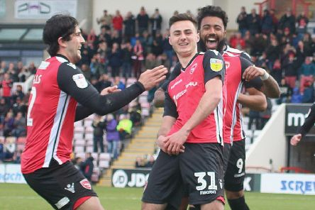 Aaron Collins celebrates putting Morecambe in front against Grimsby Town last weekend