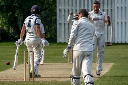 Garstang bowler Danny Gilbert celebrates taking a wicket     Picture: Tim Gilbert/Preston Photographic Society