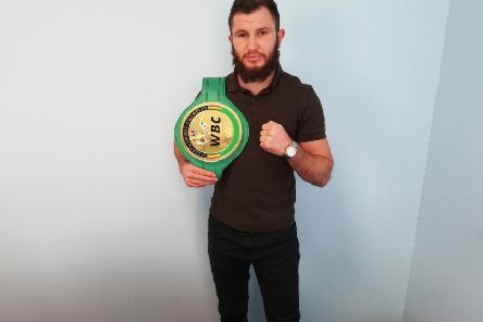 Isaac Lowe with his WBC International belt.