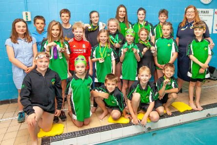 Housebuilder jumps in to help swimming club