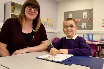 Headteacher Debbie Procter with a pupil at the new Holden School