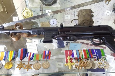 Burden Schmeisser on display in the Lancashire Infantry Museum. Lt Col George Burdens medals, including his DSO and Bar, are in the lower left of the picture