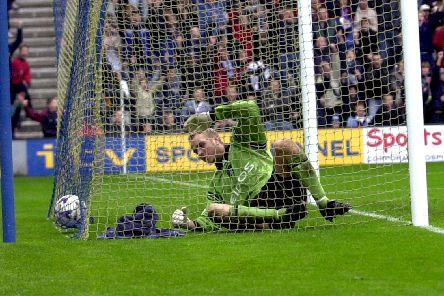 Manchesyer City goalkeeper Nicky Weaver ended up in the back of the net with the ball after being beaten by Jonathan Macken's shot
